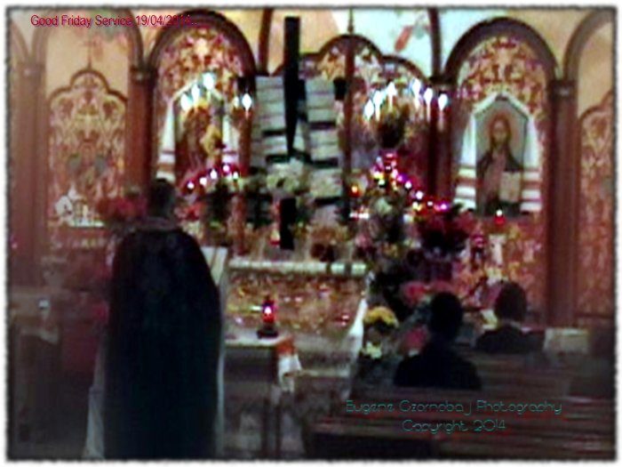 Ukrainian Catholic priest prays during Good Friday service.