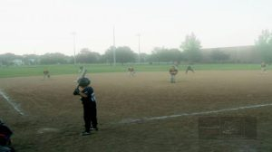 Dreamy scene, a Peewee baseball game in municipal park.