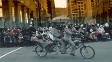 Carbon tax free drive on Saint Catherine street on three-people powered bicycle.