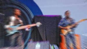 Camera malfunction resulted in blur of jazz guitar duo.