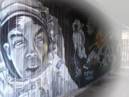 Quebec space cadets graffiti in backyard tunnel exiting onto street.