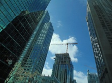 Enveloped sky surrounded by skyscrapers.
