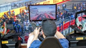 Grand Prix kiddie busy checking out new race video game.