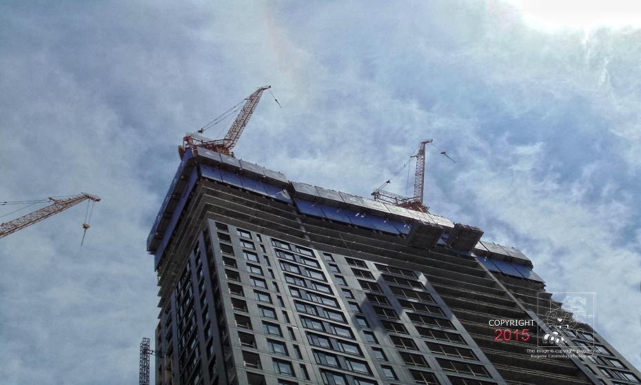 Crane operation is monster tower alongside the massive Bell Center.