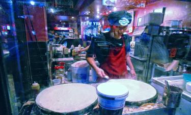 Making perfect evening crepes seems what this young oriental chef is doing.