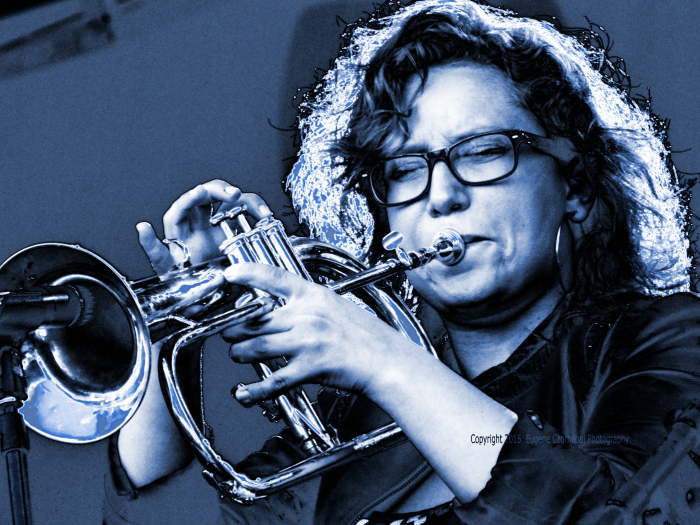 Rachel Therrien's extra ordinary lips on her shiney brass trumpet.