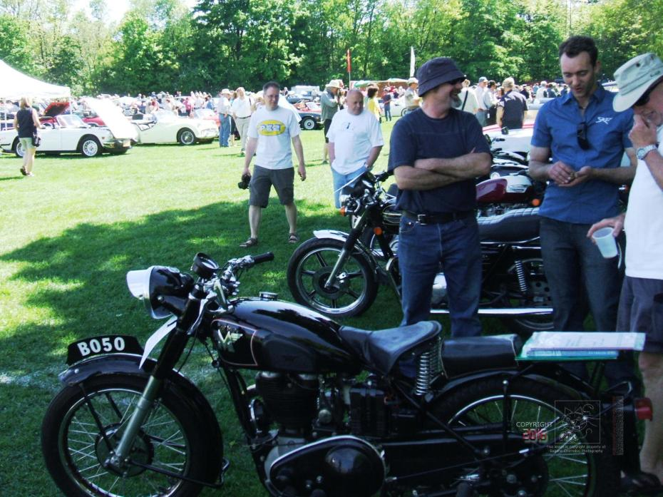 A Matchless state of mind captured in three admirers' facial expressions of the old British classic motorcycle.