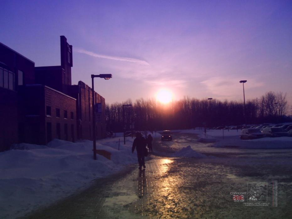 Three half light strangers head towards the warmth of community center.