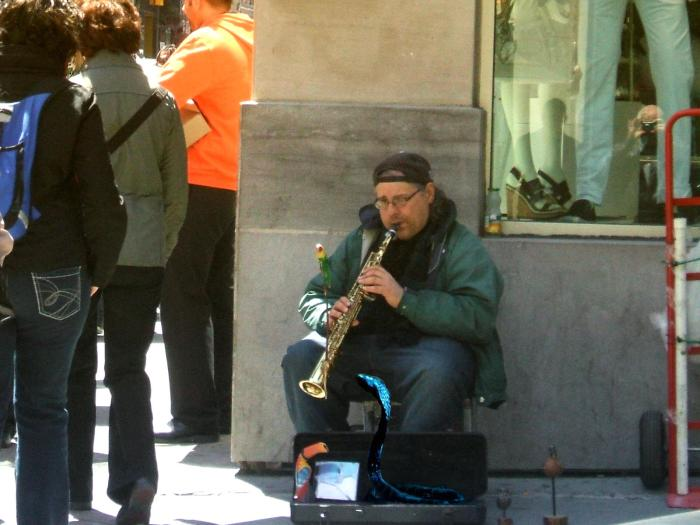 The St. Catherine street charmer playing his instrument and nobody noticed.