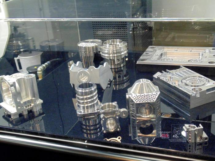 Sample of countless parts made by multi-axis N/C machines shown here.