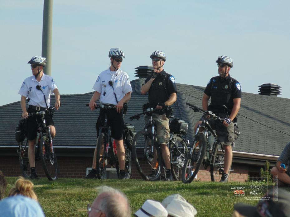 Four cool bicycle voyageurs of Montreal Police Bicycle Squad enjoying Blues Fest.