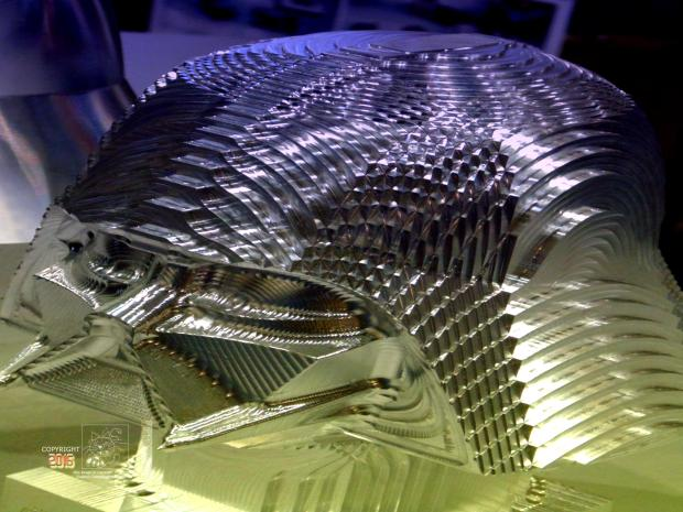 Many curves machined in Vader head bust by an N/C miller.