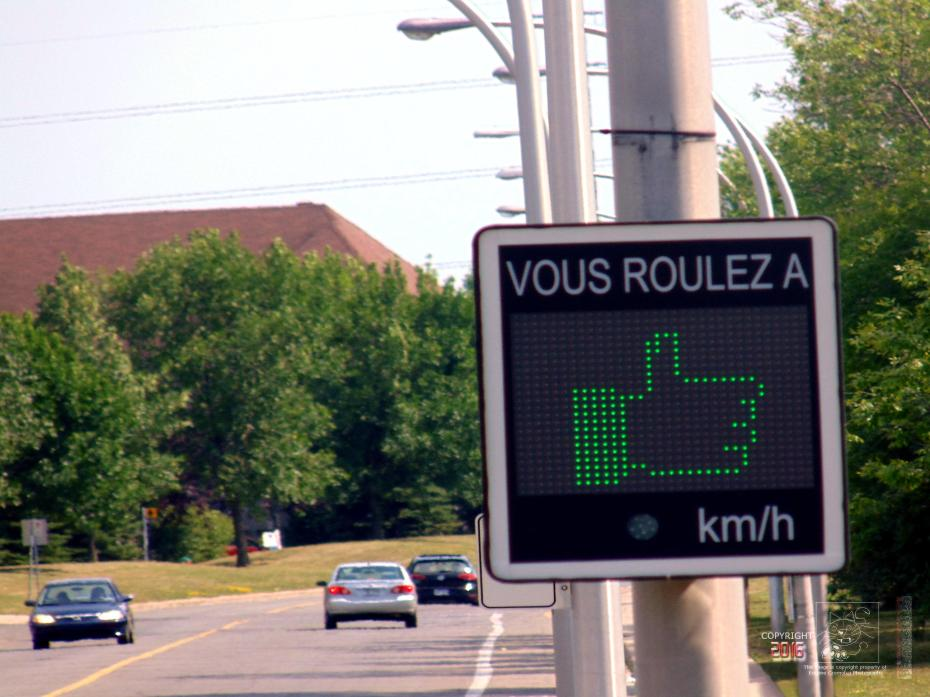 The admire symbol is the thumbs up icon for obeying 30 km/hour law.