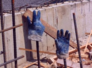 A confused message, if it exists, given by these worker's gloves showing number eight may be just a joke.