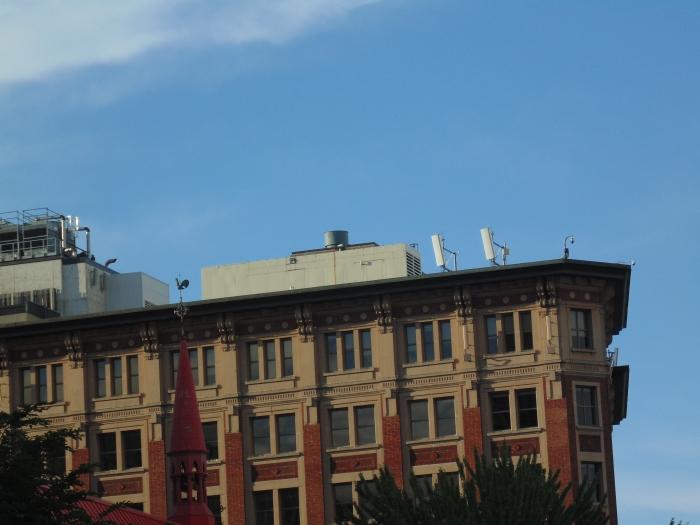 Narrow microwave communication panels and cameras on rooftop in Montreal's Chartier des Spectacles.