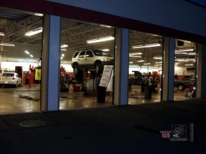 A trained automotive expert working in garage checks problems your car has to do repairs.