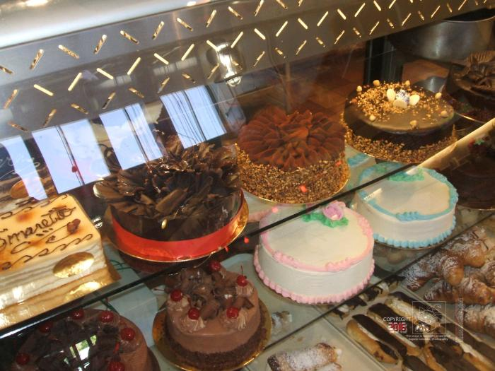 Stylish cakes behind the glass beckoned me silently to stop and buy them.