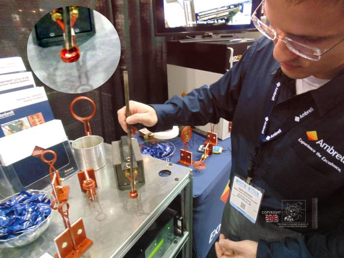The thermocoil heattreat test demonstrated by Ambrell engineer shows end of steel rod glowing melting hot.