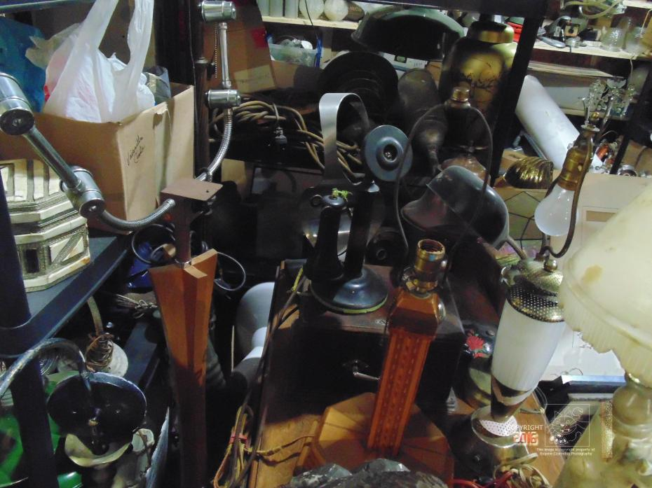 Organized chaos of stuff depicted in image is the norm at Saint Michael flea indoor flea market.