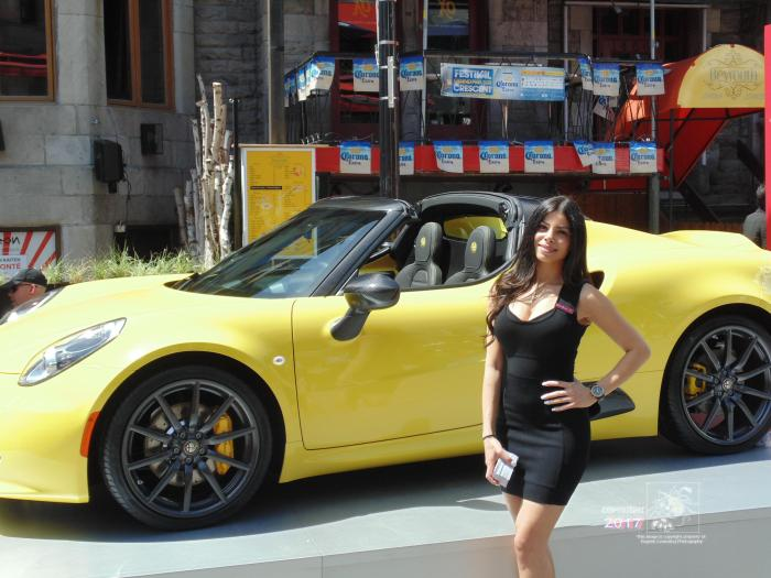 """Canary yellow Porche 911 Carrera-4S """"soft top"""" 420 hp engine accelerating from 0 to 100 km/h in 4.2 seconds."""