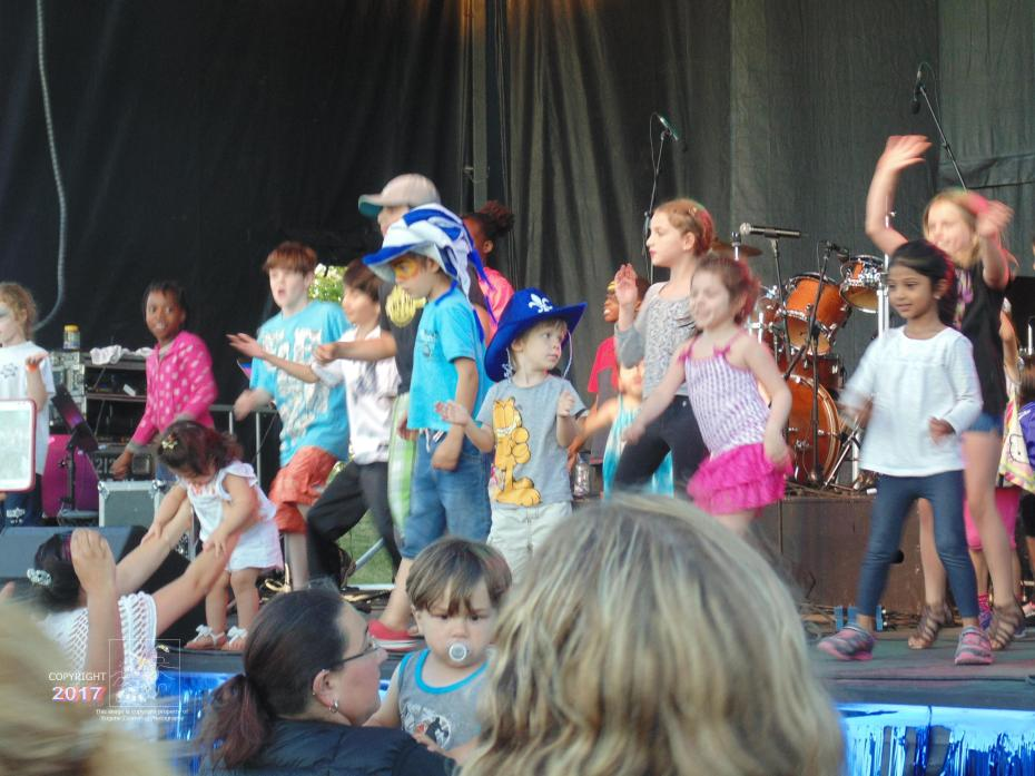 2016 Canada Day celebrations included baby on stage having fun with other little ones.