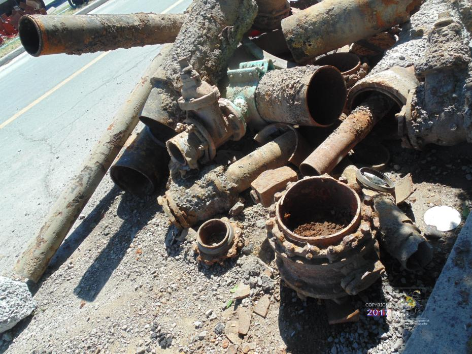 Seriousness of corrosion evident in pieces of rusted pipes, valves, and various spices, rings, bolts, and nuts dug up.