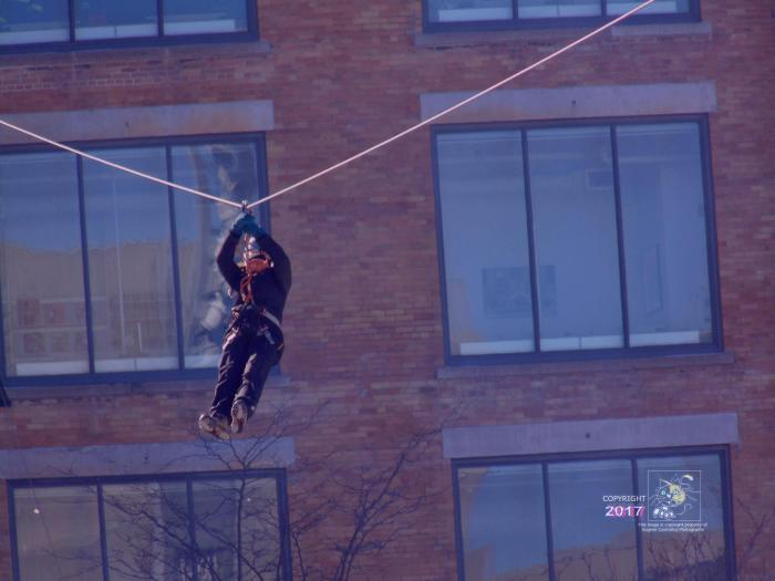 """Solitude person has riding """"Zipline"""" reset after adrenalin rush and reaching destination."""