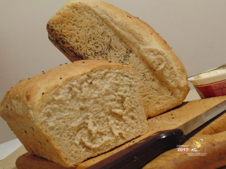 Freshly baked dense whole wheat bread slice with butter or margarine and some jam makes nice snack.