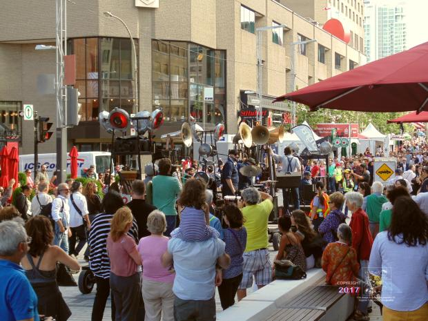 At 5 PM sharp excited swarm of Jazz fans greets West Tranz troupe entering Quartier-des-Spectacles entertainment area.