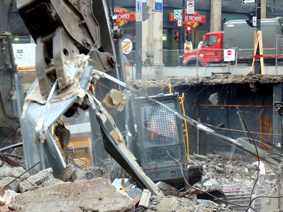 Total building destruction is minimal mechanical effort with crushing hydraulic monster metal jaws.