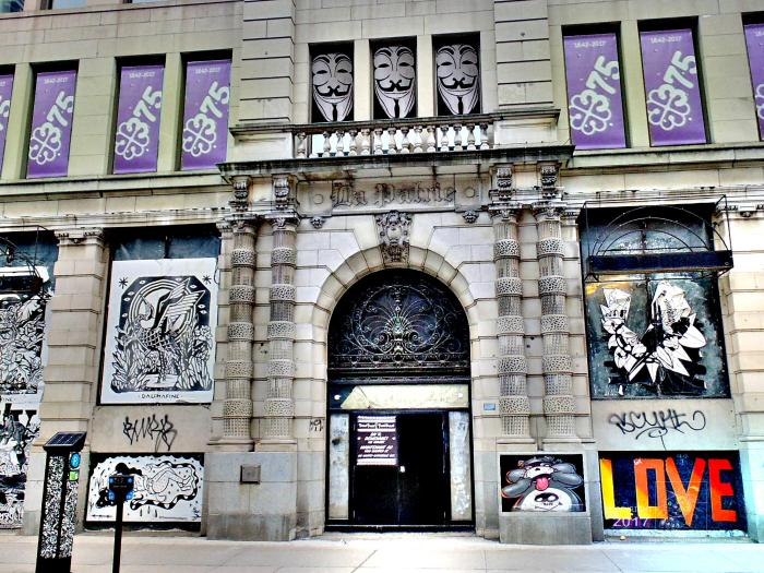 Graphic harmony exists in La Patrie building on Saint Catherine combining excellent, classic, archectural design, metal work, street art, and posters.