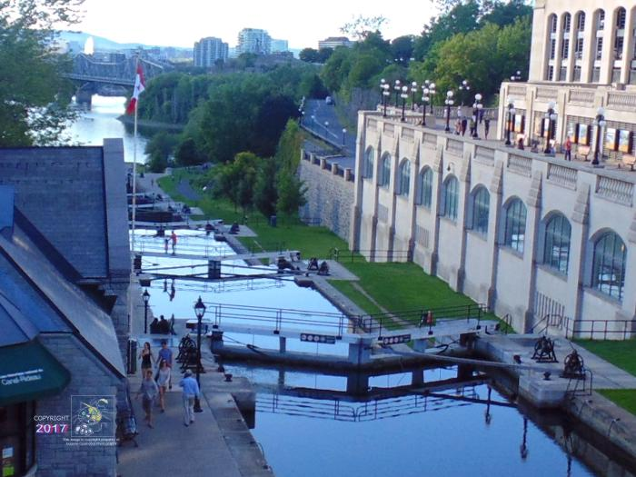 Part of Ottawa's historic Rideau Canal descend shown built after War of 1812 extends down to Ottawa River.