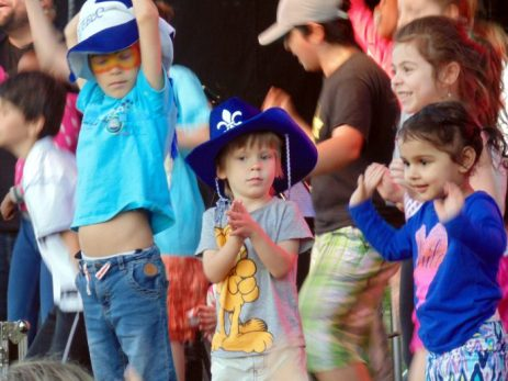 Excited children commit much fun on stage during 2016 Saint Jean Baptiste day celebrations in borough on Montreal's West Island.