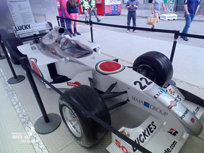 Sleek formula 1 race car by Honda named Lucky has taper very evident right up front in at least two places.