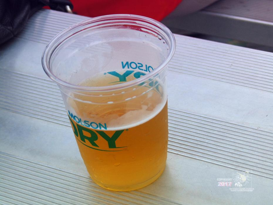 Refreshing out-of-bottle experience is having ice-cold Molson brewski on hot day enjoying West Island Blues Festival music.