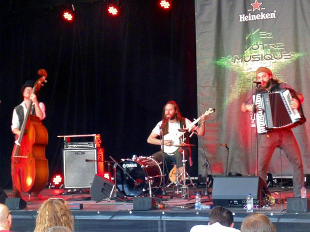 Place Heineken beer tent is scene where non-traditional trio busker-alley cats band called Street Meat perform.