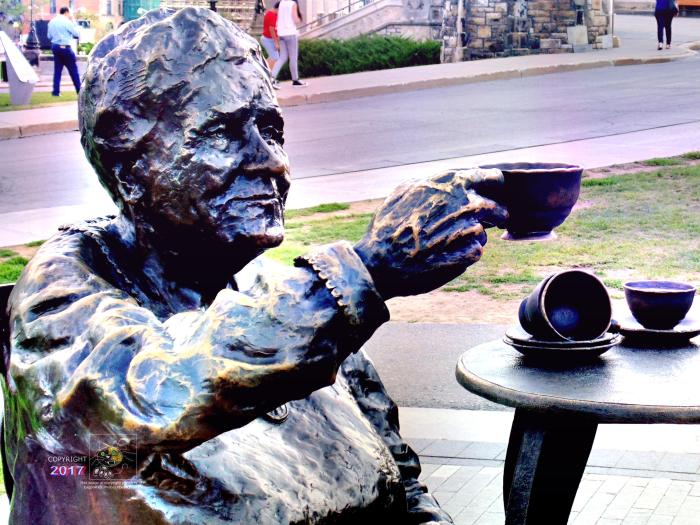 One of Famous Five, Henrietta Muir Edwards, raises cup during tea time on Parliament Hill welcoming everyone to drop by.