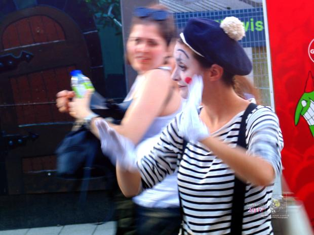 """Casual mime with white gloves directs visitor """"traffic"""" during 2017 Montreal Just For laughs Festival."""
