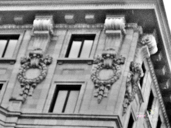Fuzzy grainy B/W example photo of some interesting old Montreal architectural detail.