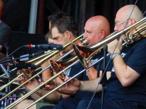 Symphony trombones section of Le Grand Ensemble Jazz De Saint-Eustache in action on Rio Tinto Stage.