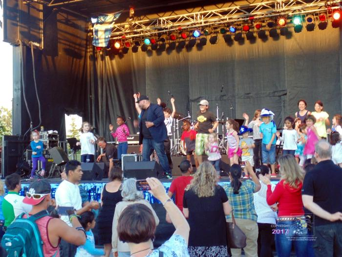 Kiddie show launch during Saint Jean Baptiste Day on outdoor stage in Montreal's West Island.