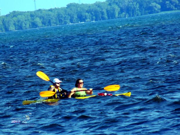 """Very risky transit by couple in kayak on wind swept choppy """"white cap"""" water of Lake Saint Louis in September."""