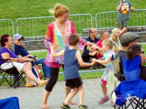Young mother in childhood dancing experience with her two children during West Island Blues Festival.