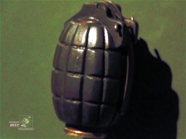 """Lethal dark green colored """"Mill's Bomb"""" egg is British designed fragmentation grenade used in WWI and WWII."""
