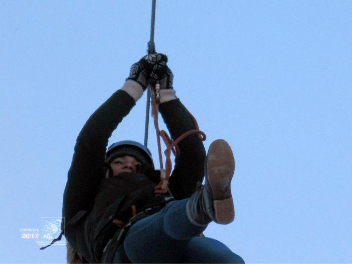 One-way trip riding on steel wire while attached in harness during Montreal en Lumiere winter festival.