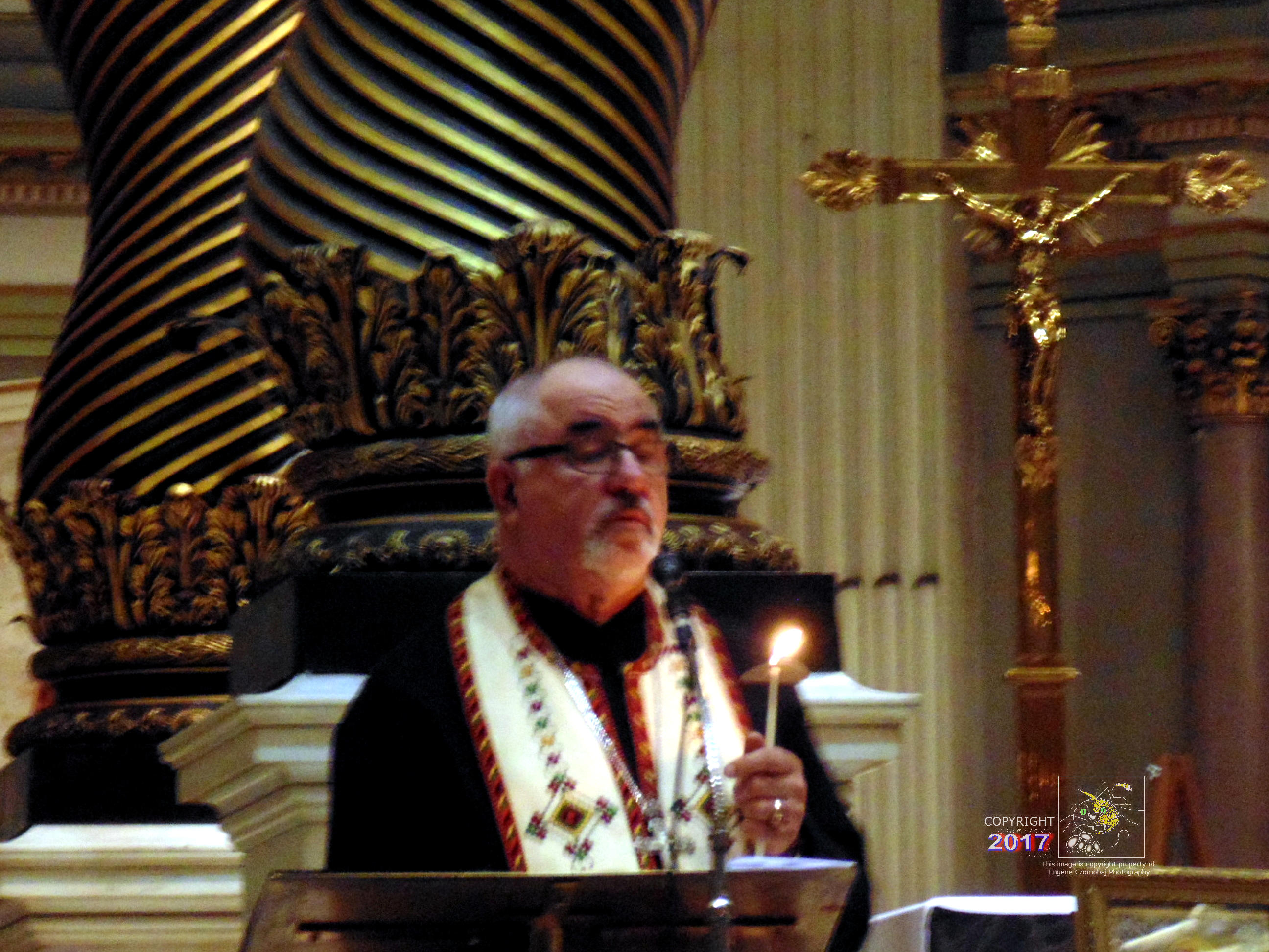 Montreal Ukrainian priest in serene moment of silence during solemn service commemorating 30th Anniversary of Chornobyl Disaster in 2016..