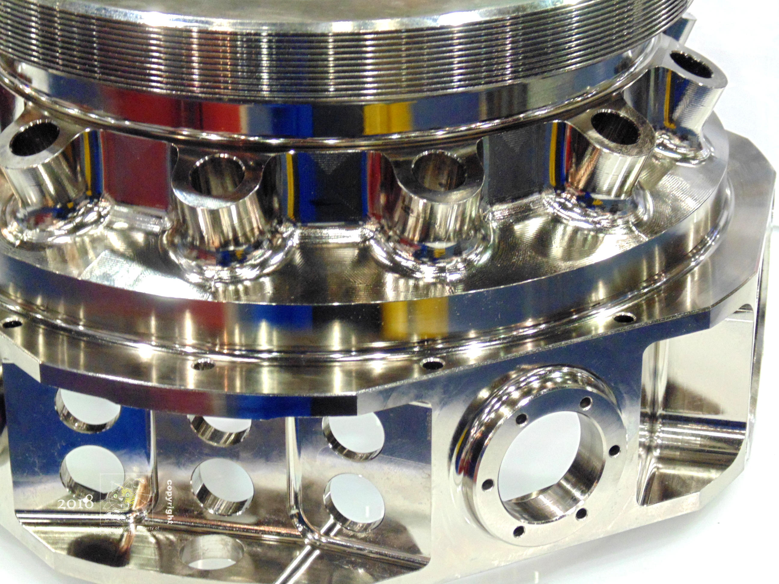 Brilliant machined stainless part exhibit piece made to impress attendees at 2016 SME Montreal Advanced Manufacturing Show.