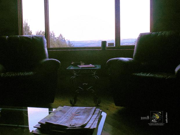 Green Mountains seen on horizon in comfort of heated, winterized cottage perched overlooking Lake Memphremagog.
