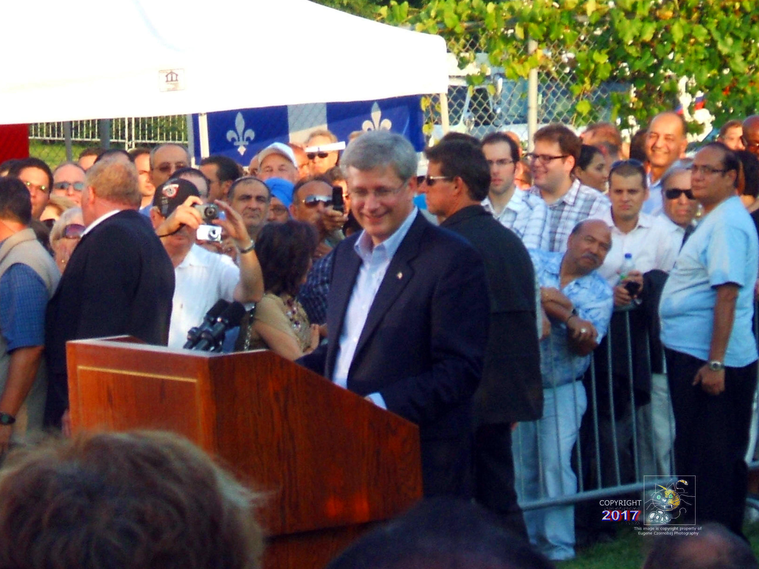 Saturday, June 15, 2013 former Canadian PM Steven Harper in political conversation with party supporters in Montreal's West Island.