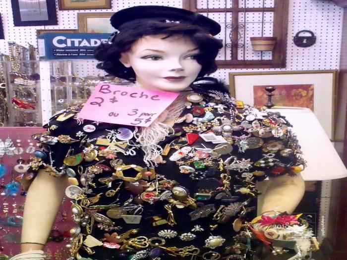 Black color ladies brooch costume at Saint Michel flea-market.